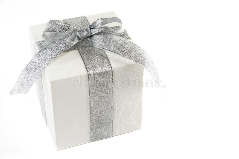 Gift box with silver bow and ribbon isolated stock photography