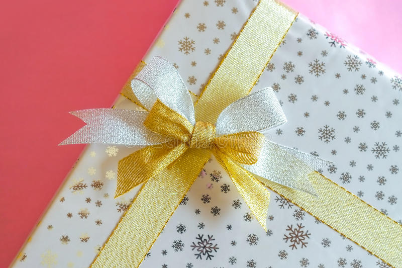 Gift box silver and gold ribbon royalty free stock photography