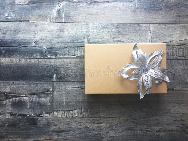 Gift box with a sliver bow stock image