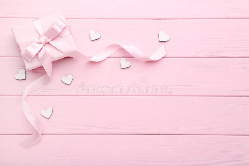 Gift box with white hearts stock photo