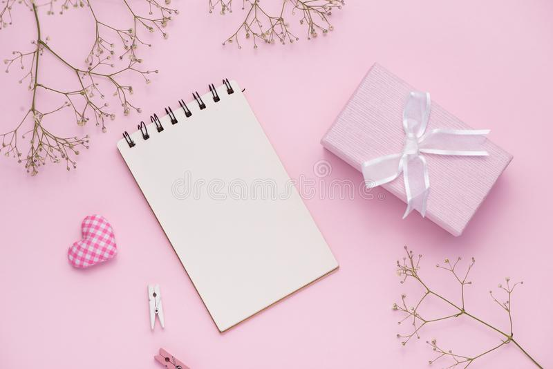 Gift box tied with pink ribbon and white flowers for mothers day stock images