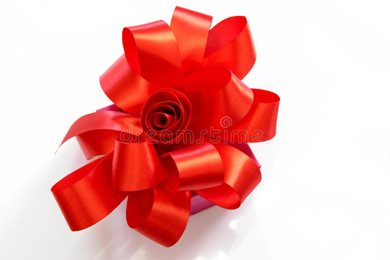 Gift box tied with a red bow. Gift box tied with a red bow on white background stock photos