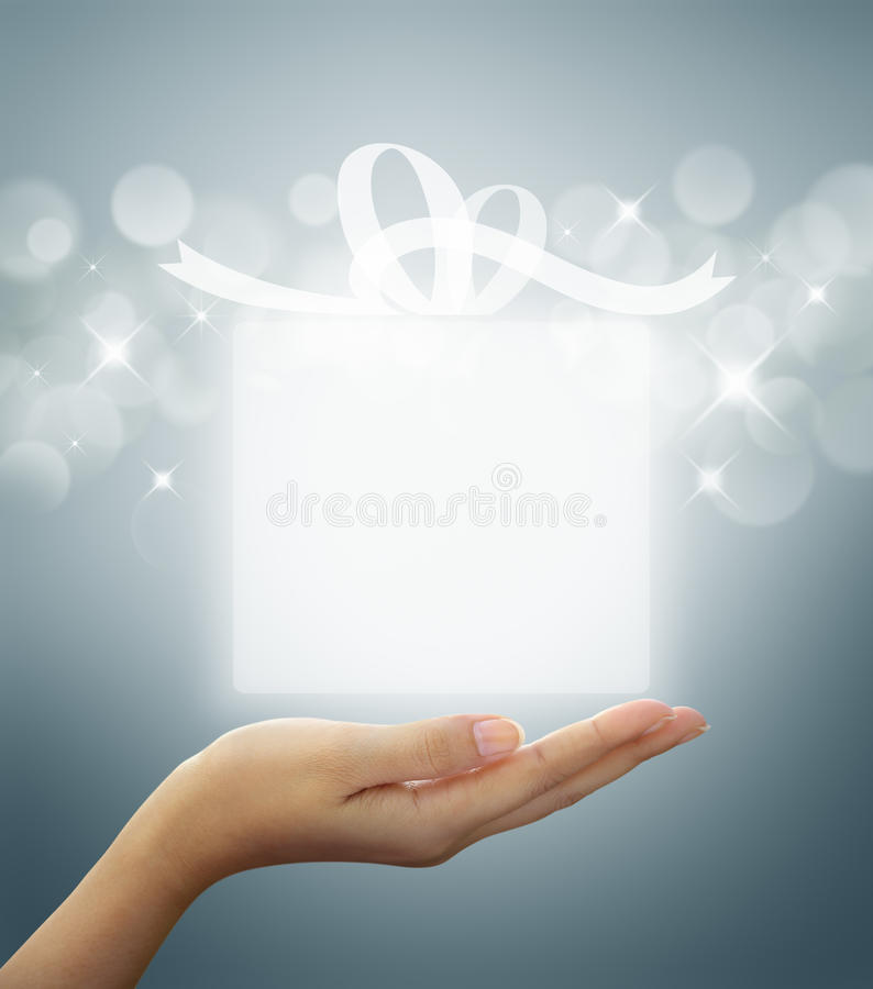 Gift box Translucent in hand. Gift box Translucent white on woman hand stock photo