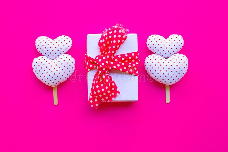 Gift box with Valentine's hearts on pink background royalty free stock photo