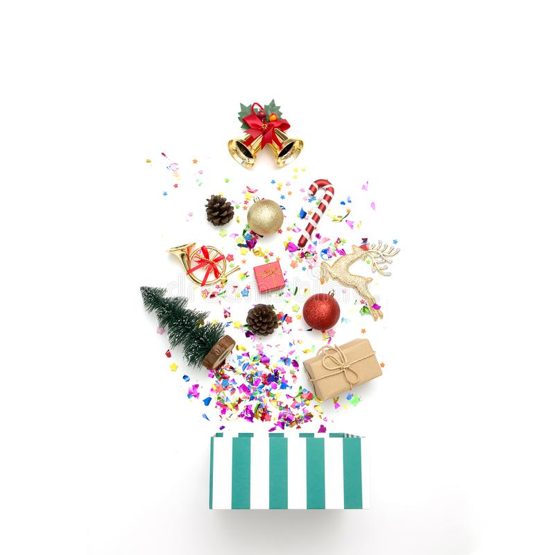 Gift box with various party confetti and christmas decoration on a white background. royalty free stock photos