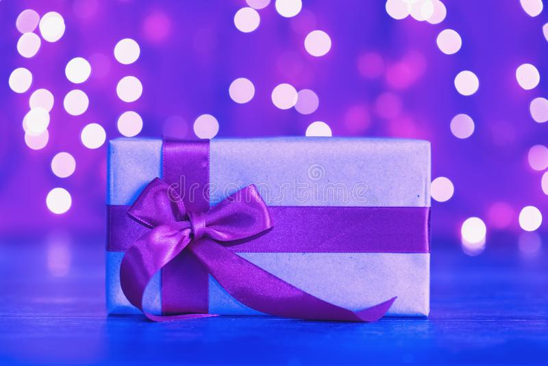 Gift box in vibrant bold gradient holographic colors. Christmas concept art. Minimal New Year surrealism.  royalty free stock images