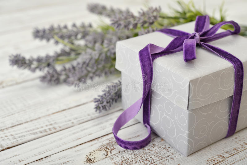 Gift box with violet ribbon royalty free stock photography
