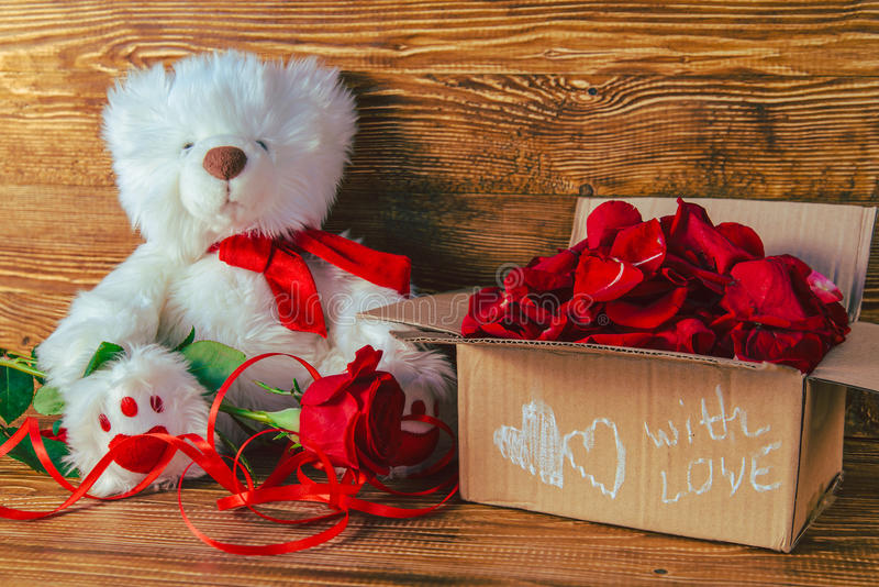 Gift box on white background. Gift box day on white background with flowers and bear royalty free stock photography