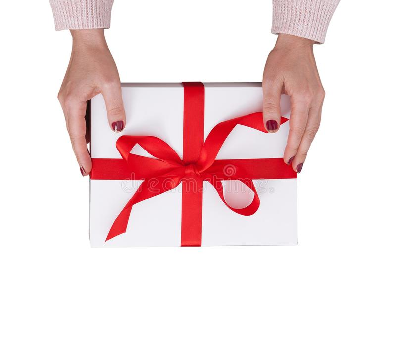 Gift box isolated on white background. Woman holding presents. stock photos
