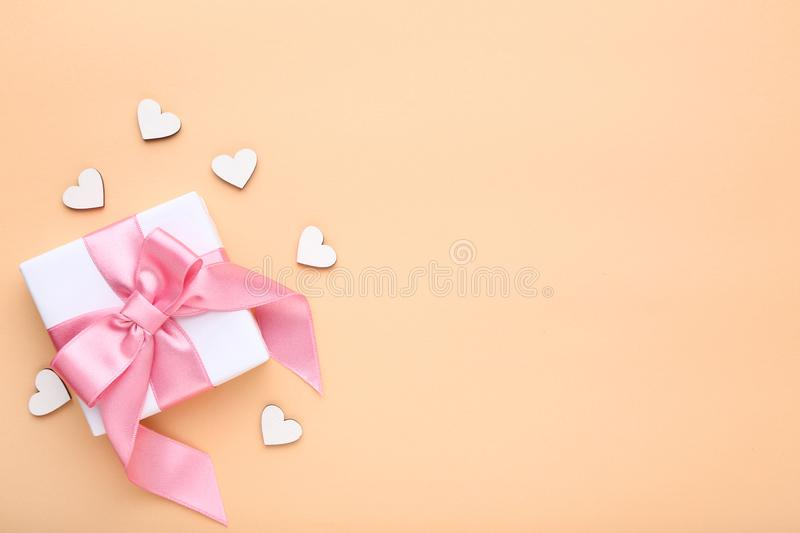 Gift box with white hearts stock image
