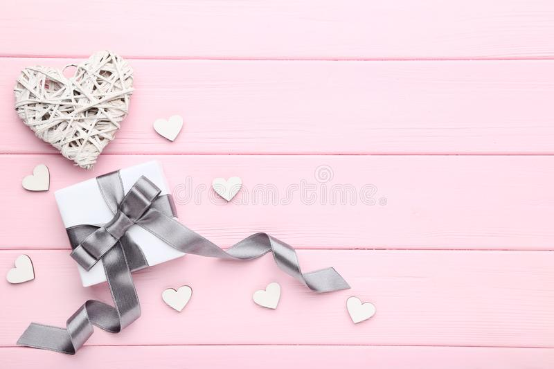 Gift box with white hearts royalty free stock image