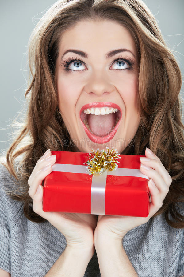 Gift box woman hold against gray background. royalty free stock image
