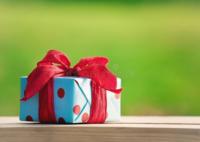Gift box on wooden table stock photo