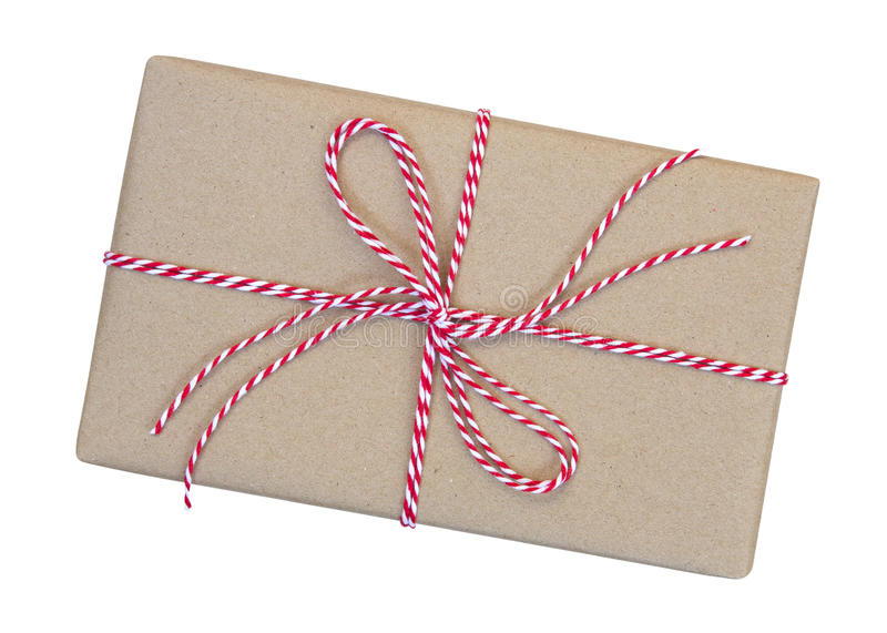 Gift box wrapped in brown recycled paper with red and white rope stock image