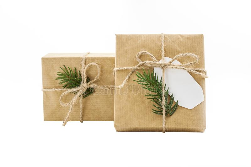 Gift box wrapped craft paper on the isolation background. Gift box wrapped in brown recycled paper and tied sack rope top view isolated on white background stock photography