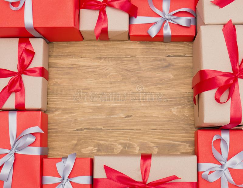 Gift box wrapped Christmas presents with bows and ribbons in shape of square stock photo