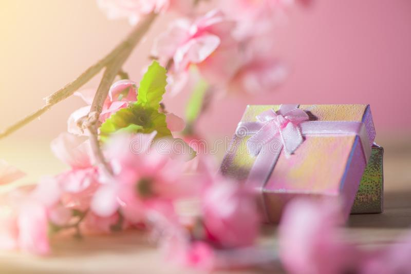 Gift box wrapped and plum blossom Christmas and Newyear presents with bows and ribbons, Christmas frame boxing day background. stock images