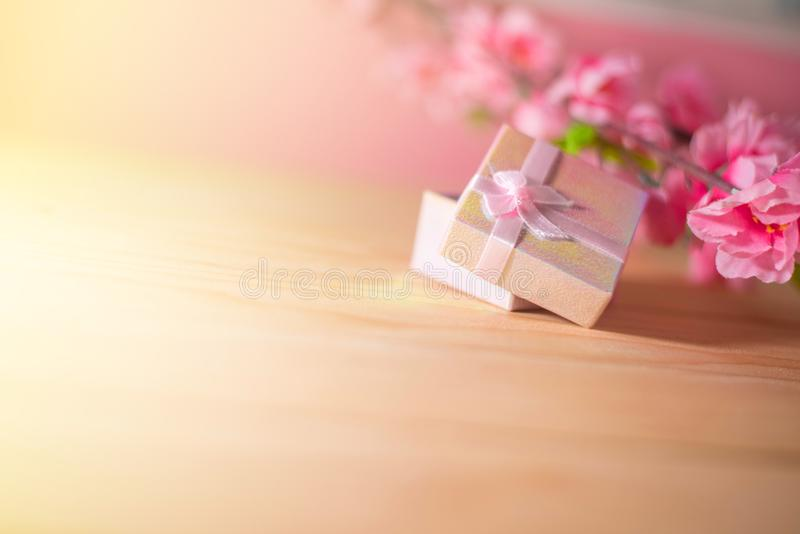 Gift box wrapped and plum blossom Christmas and Newyear presents with bows and ribbons, Christmas frame boxing day background. Gift box wrapped and plum blossom royalty free stock photo