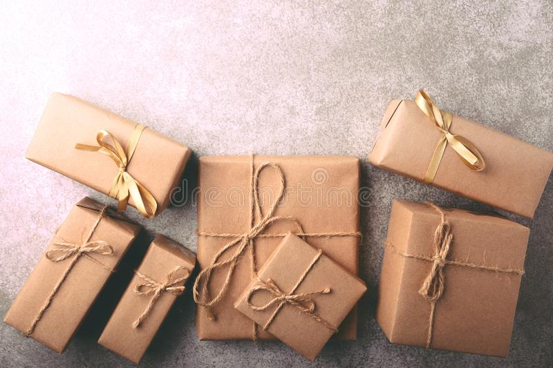 Gift box wrapped in recycled paper with ribbon bow royalty free stock photography