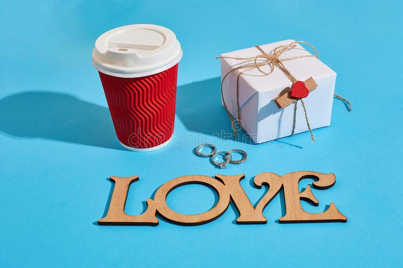 Gift box wrapped in recycled paper with ribbon bow and paper cup royalty free stock photography