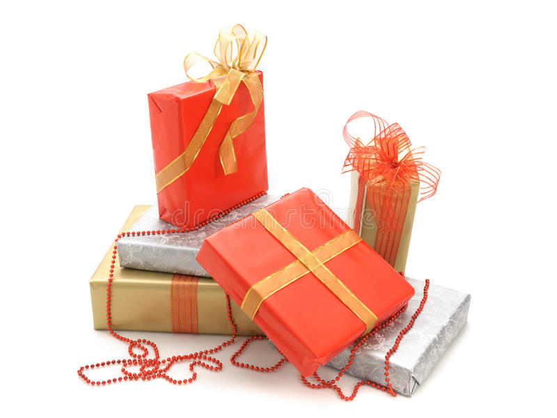 Gift boxes. And christmas balls, on white royalty free stock image