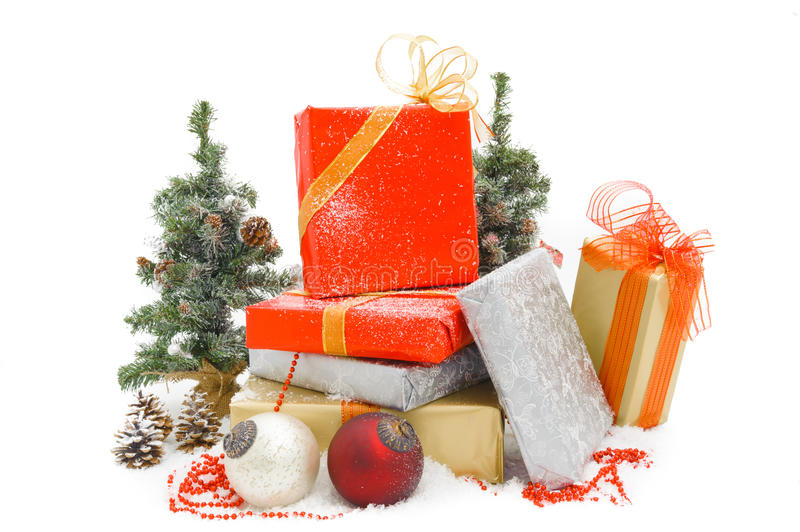 Gift boxes. And christmas balls, on white royalty free stock images