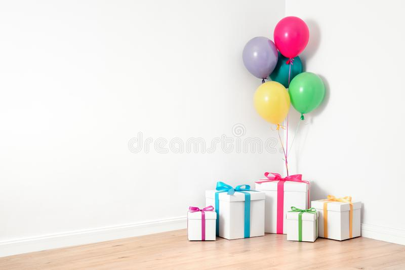Gift boxes and balloons stock photo