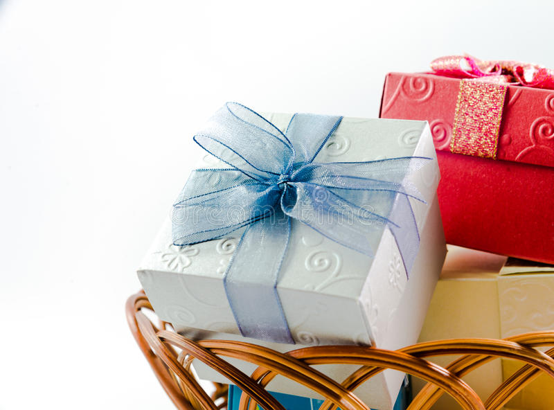 Gift boxes on basket isolated royalty free stock photo