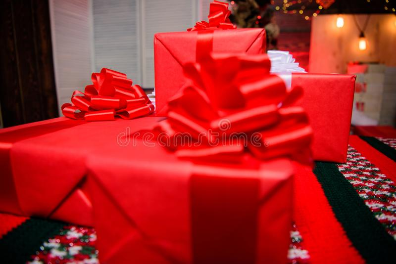 Gift boxes with big ribbon bow close up. Red wrapped gifts or presents. Prepare for christmas and new year. Wrapping royalty free stock photography