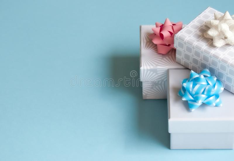 Gift boxes on blue background royalty free stock photos