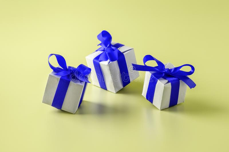Gift boxes with blue bows on yellow background.  stock image