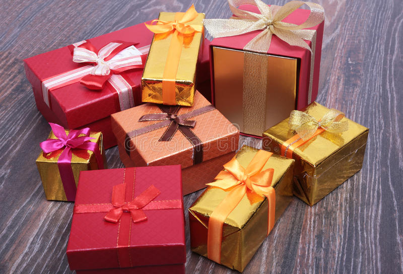 Gift boxes with bow on wood background.  stock image