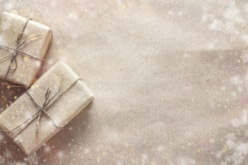 Gift boxes on brown wrapping paper. Christmas background. Space royalty free stock photos