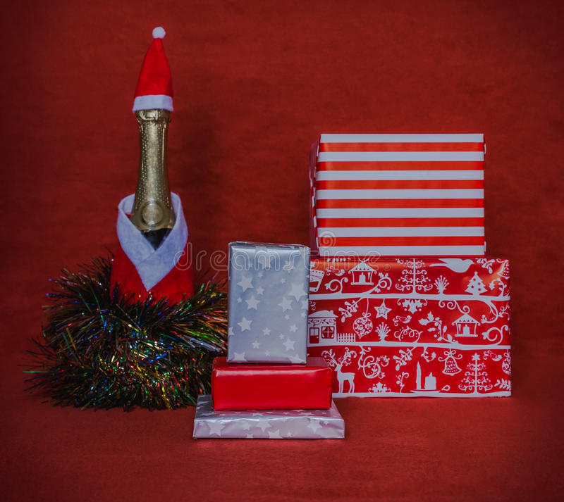 Gift boxes with champagne bootle royalty free stock image
