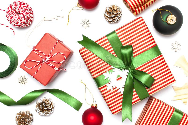 Gift boxes, Christmas balls, toys, fir cones, ribbon on white background. Festive, congratulation, New Year Christmas presents Xma royalty free stock photos