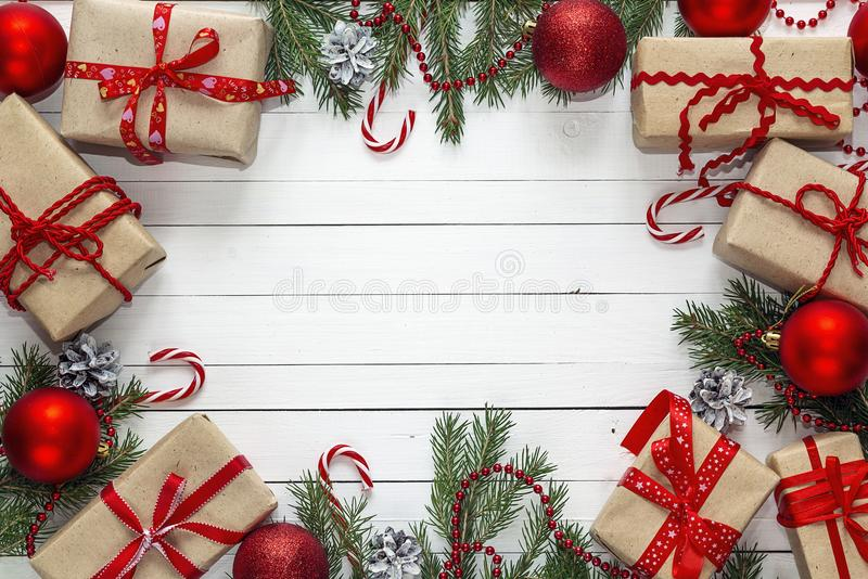 Gift boxes and Christmas decorations on white wooden background. stock photo