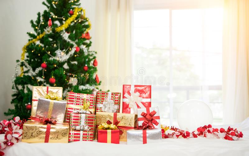 Gift boxes with Christmas tree at the background royalty free stock images