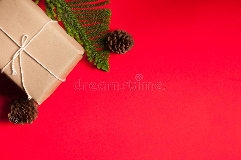 Gift boxes, dried pine and pine leaf were placed. As a concept For Christmas On a red background stock photo