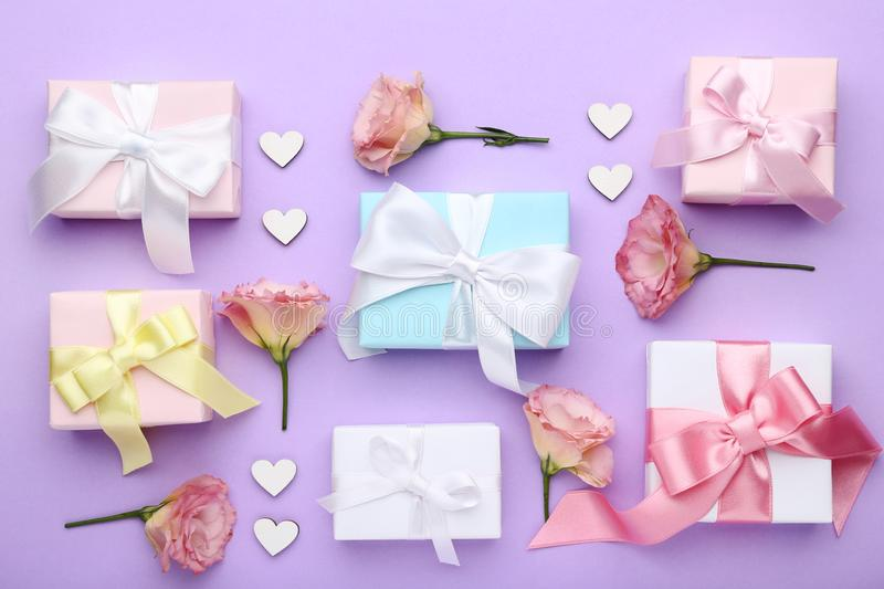 Gift boxes with eustoma flowers stock images