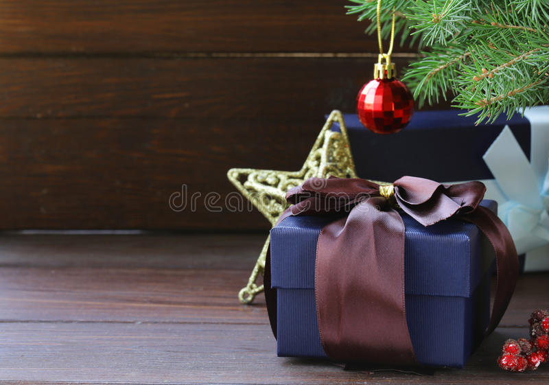 Gift boxes with festive ribbons and Christmas decorations royalty free stock images