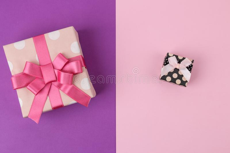 Gift boxes. Gifts on a bright lilac and pink background. Holidays. Valentine`s Day. women`s Day. mother`s day. view from above stock photo