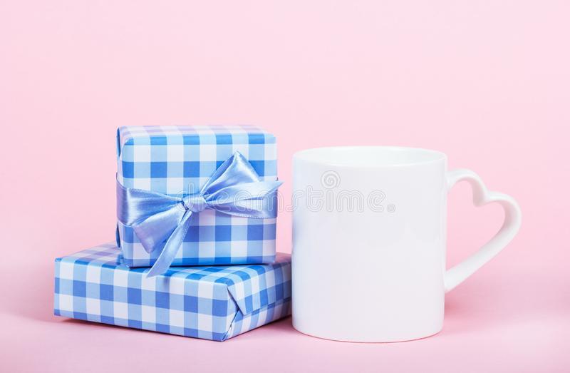 Gift boxes and mug. Valentine`s day holiday. Cup with heart royalty free stock image