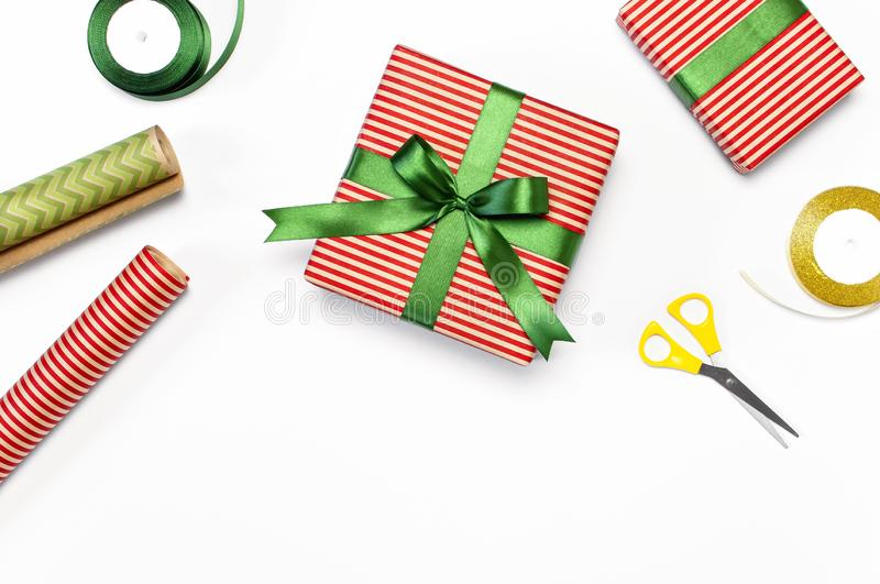 Gift boxes, packing paper, scissors, ribbon on white background. Festive background, congratulation, gift wrapping, Christmas and royalty free stock photography