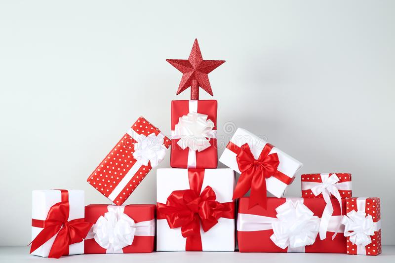 Gift boxes with ribbon and red star stock images
