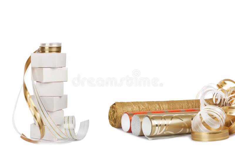 Gift boxes and rolls of wrapping paper stock photos