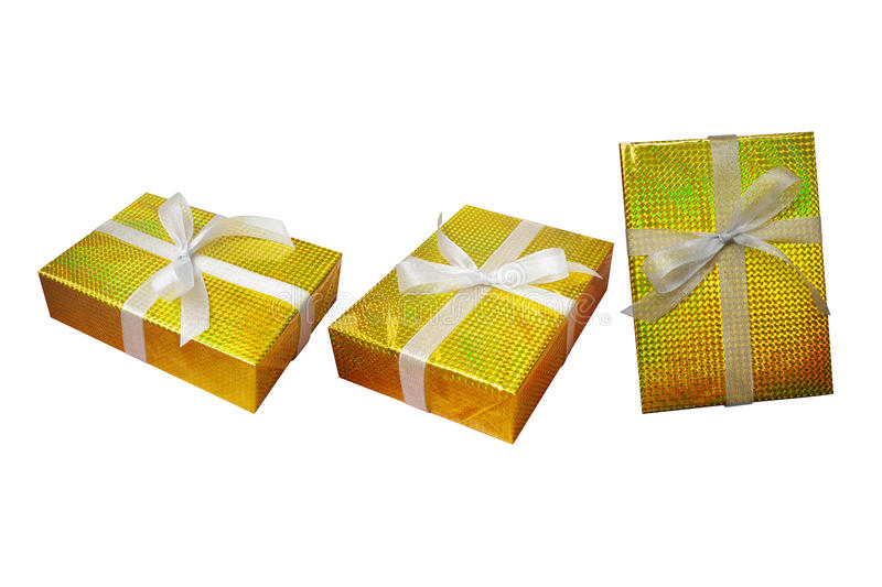 Gift boxes set wrap and ribbon with gold foil multicolor shiny w. Rapping paper and white silver bow ribbon isolated on white background, clipping path included stock image