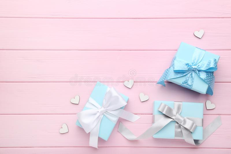 Gift boxes with white hearts stock photography