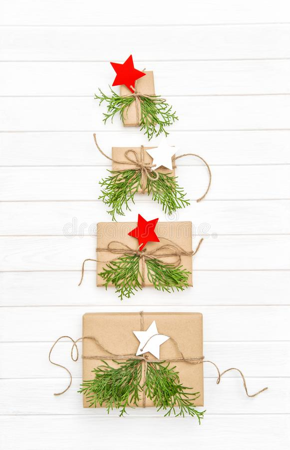 Gift boxes star shaped Christmas tree Advent decoration. Gift boxes with star tags shaped Christmas tree on white background. Advent decoration stock images