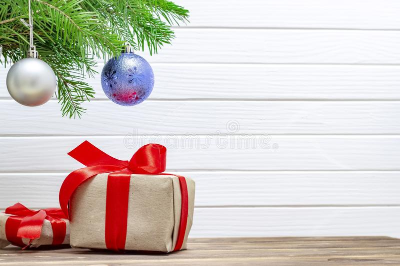 Gift boxes under christmas tree. Christmas background. White, branch, celebration, green, spruce, present, xmas, decoration, festive, fir, holiday, red, winter royalty free stock photo