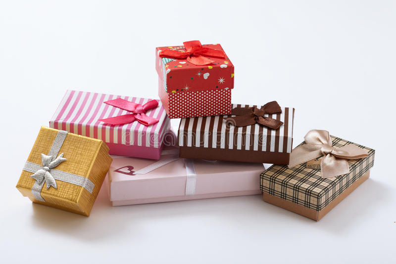 Gift boxes on white background top view. Open gift box on white background close up top view royalty free stock images